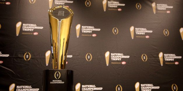 This Monday, July 14, 2014 photo shows the College Football Playoff National Championship Trophy in Irving, Texas. A rising g