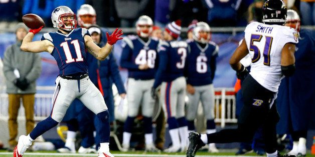 FOXBORO, MA - JANUARY 10:  Julian Edelman #11 of the New England Patriots throws a touchdown pass on a flea flicker play duri