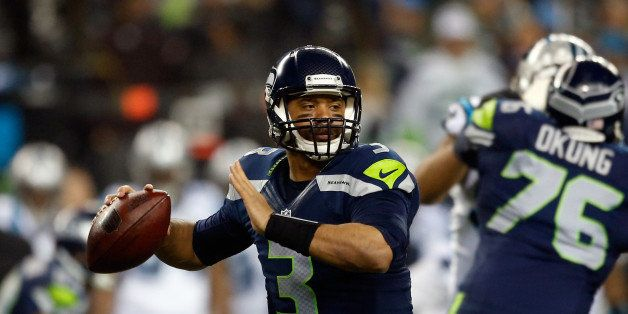 SEATTLE, WA - JANUARY 10:  Russell Wilson #3 of the Seattle Seahawks throws the ball in the first half against the Carolina P