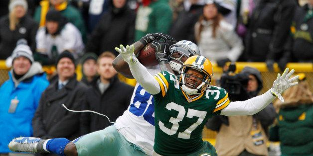 Dallas Cowboys wide receiver Dez Bryant (88) catches a pass against Green Bay Packers cornerback Sam Shields (37) during the