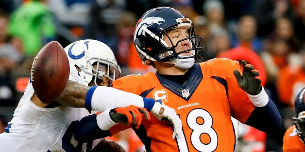 Indianapolis Colts linebacker Jonathan Newsome, left, reaches in to force Denver Broncos quarterback Peyton Manning fumble du