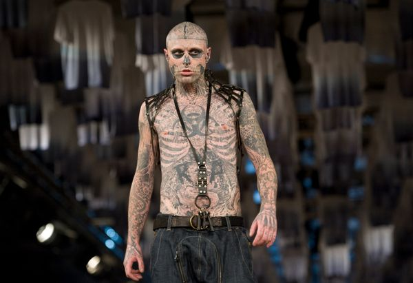 Rick Genest is a walking zombie skeleton, complete with his head shaved and a brain inked in in place of hair. The inspiratio