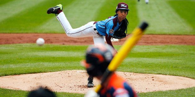FILE - In this Aug. 15, 2014, file photo, Philadelphia's Mo'ne Davis delivers in the first inning against Nashville's Robert