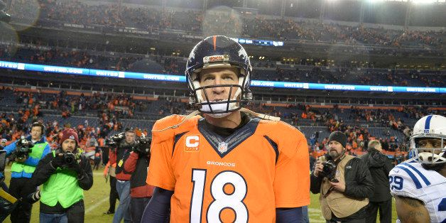 DENVER, CO - JANUARY 11: Peyton Manning (18) of the Denver Broncos walks off the field after losing to the Colts. The Denver