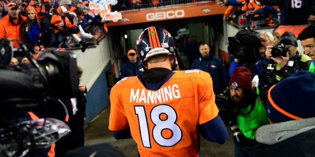 DENVER, CO - JANUARY 11: Peyton Manning (18) of the Denver Broncos walks off the field after losing to the Colts 24 to 13.  T