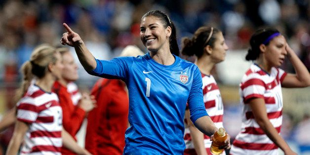 United State's Hope Solo (1) points the crowd after defeating China 2-0 in an international friendly soccer match at Ford Fie