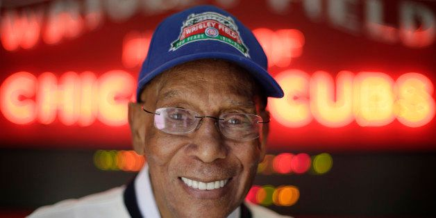 In this March 24, 2014, photo Chicago Cubs' Hall of Famer Ernie Banks smiles after an interview at the Cubs offices in Chicag
