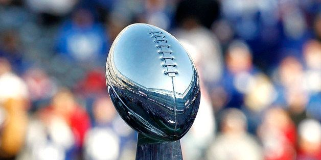 EAST RUTHERFORD, NJ - FEBRUARY 07:  The George Halas Trophy for the NFC Championship and the Vince Lombardi Trophy are displa