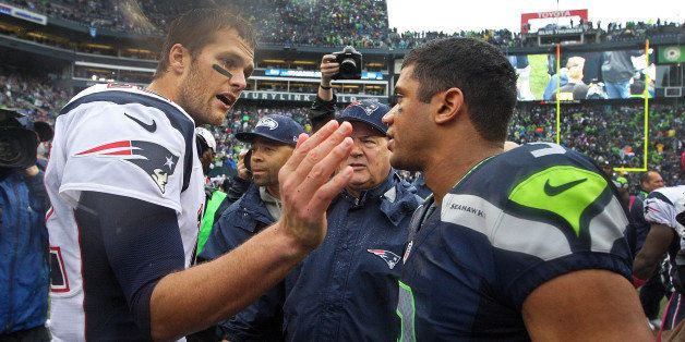 SEATTLE - OCTOBER 14: Patriots quarterback Tom Brady, left, has a word and a pat for Seattle quarterback Russell Wilson, righ