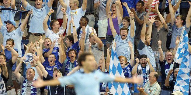 KANSAS CITY, KS - AUGUST 17:  Sporting Kansas City fans cheer after Graham Zusi #8 of Sporting Kansas City scored a goal duri