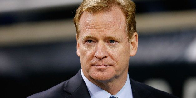 DETROIT, MI - NOVEMBER 24:  Commissioner of the National Football League Roger Goodell watches the pregame warms up prior to