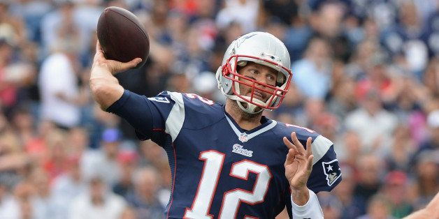 FOXBORO, MA - SEPTEMBER 21:  Tom Brady #12 of the New England Patriots throws the ball in the first quarter during a game aga