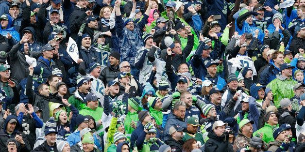 SEATTLE, WA - JANUARY 18:  Fans of the Seattle Seahawks cheer during the 2015 NFC Championship game against the Green Bay Pac