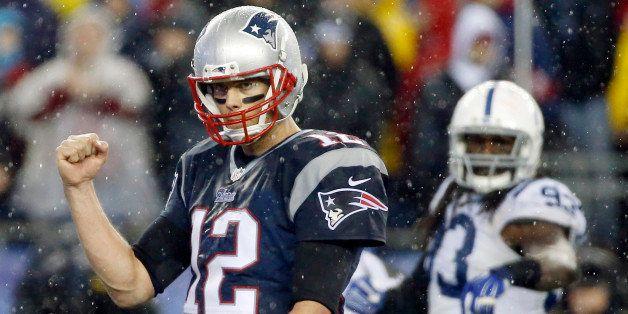 New England Patriots quarterback Tom Brady (12) celebrates LeGarrette Blount's touchdown during the second half of the NFL fo