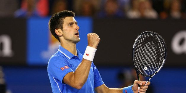 MELBOURNE, AUSTRALIA - FEBRUARY 01:  Novak Djokovic of Serbia celebrates a point in his men's final match against Andy Murray