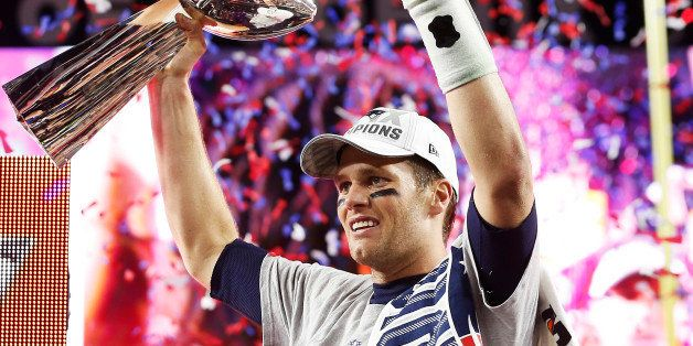 GLENDALE, AZ - FEBRUARY 01:  Tom Brady #12 of the New England Patriots celebrates with the Vince Lombardi Trophy after defeat