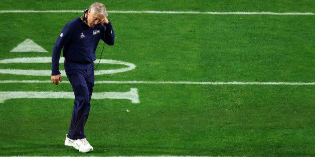 GLENDALE, AZ - FEBRUARY 01:  Head coach Pete Carroll of the Seattle Seahawks looks dejected after defeat to the New England P