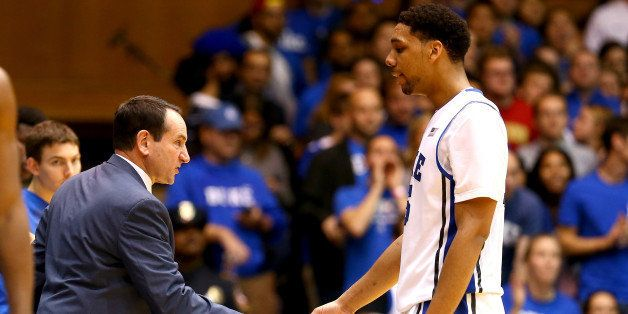 DURHAM, NC - DECEMBER 15:  Head coach Mike Krzyzewski congratulates Jahlil Okafor #15 of the Duke Blue Devils as he walks to