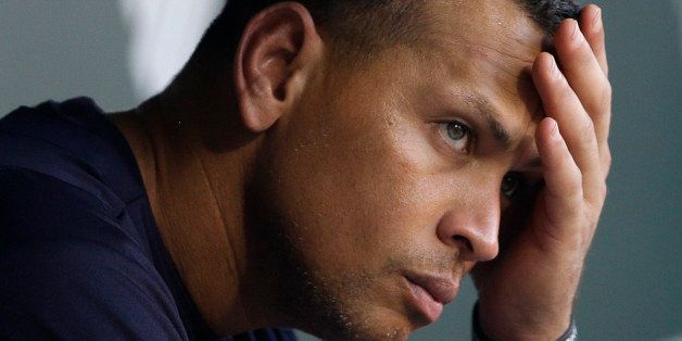 FILE - In this Sept. 11, 2013, file photo, New York Yankees' Alex Rodriguez wipes sweat from his brow as he sits in the dugou