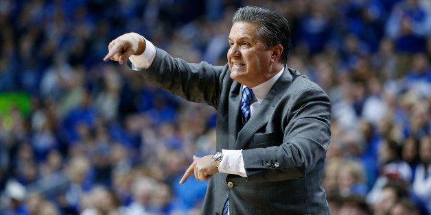 LEXINGTON, KY - JANUARY 20: Head coach John Calipari of the Kentucky Wildcats coaches from the sideline against the Vanderbil