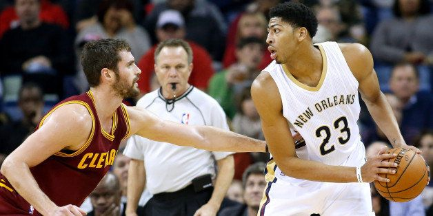 New Orleans Pelicans forward Anthony Davis (23) drives against Cleveland Cavaliers forward Kevin Love (0) during the first ha