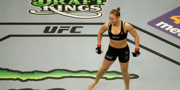 LOS ANGELES, CA - FEBRUARY 28:  An overhead view of Ronda Rousey celebrating her victory over Cat Zingano in their UFC women'