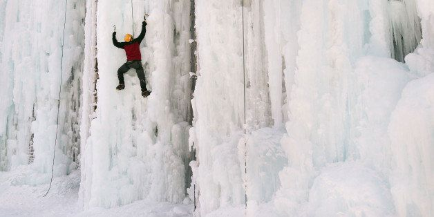 CEDAR FALLS, IA - FEBRUARY 18:  Adam Kuperman climbs the side of an ice-covered grain silo February 18, 2007 in Cedar Falls,