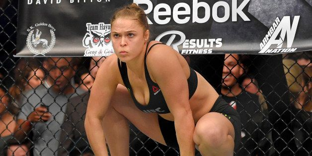 Ronda Rousey gets ready to fight Cat Zingano in a UFC 184 mixed martial arts bantamweight title bout, Saturday, Feb. 28, 2015, in Los Angeles. Rousey won after Zingano tapped out 14 seconds into the first round. (AP Photo/Mark J. Terrill)