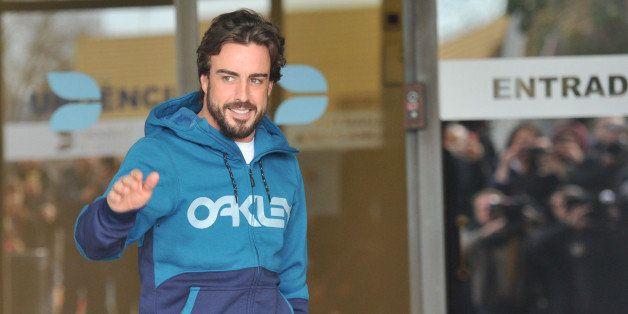BARCELONA, SPAIN - FEBRUARY 25:  Formula 1 pilot Fernando Alonso is seen leaving Cataluna Hospital on February 25, 2015 in Ba