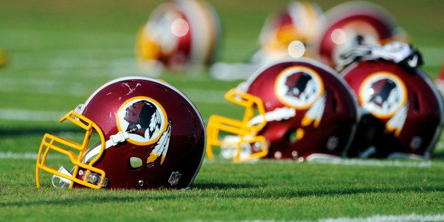 FILE - In this June 17, 2014, file photo, Washington Redskins helmets sit on the field during an NFL football minicamp in Ash