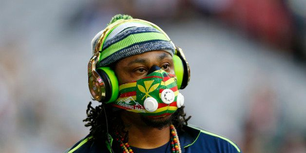 GLENDALE, AZ - FEBRUARY 01:  Marshawn Lynch #24 of the Seattle Seahawks warms up prior to Super Bowl XLIX against the New Eng