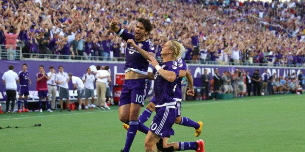 ORLANDO, FL - MARCH 08:  Kaka #10 of Orlando City SC celebrates after he scores the first goal in team history during an MLS