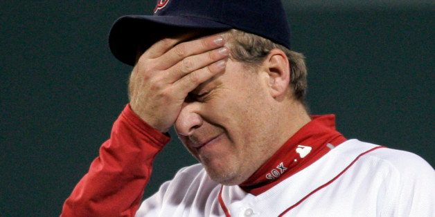 ** FILE ** In this Oct. 13, 2007 file photo, Boston Red Sox pitcher Curt Schilling reacts after giving up a solo home run to