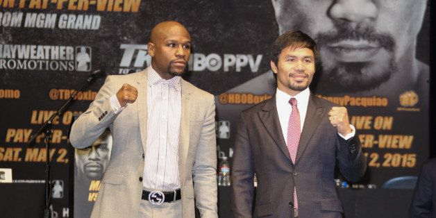 LOS ANGELES, CA - MARCH 11:  Profesional Boxers Floyd Mayweather and Manny Pacquiao attend the press conference to announce u