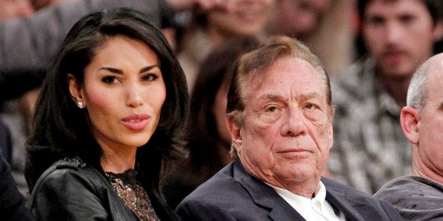 FILE - In this Dec. 19, 2011, file photo, Los Angeles Clippers owner Donald Sterling, right, sits with V. Stiviano as they wa