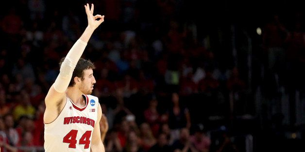 LOS ANGELES, CA - MARCH 28:  Frank Kaminsky #44 of the Wisconsin Badgers reacts making a three-pointer in the second half aga