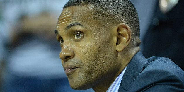 CHARLOTTE, NC - MARCH 20:  College basketball analyst, Grant Hill, watches on before the game between the Georgia Bulldogs an