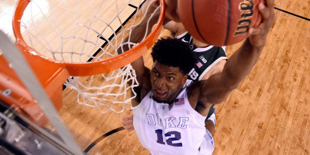 INDIANAPOLIS, IN - APRIL 04: Justise Winslow #12 of the Duke Blue Devils goes up for a dunk in the second half against the Mi