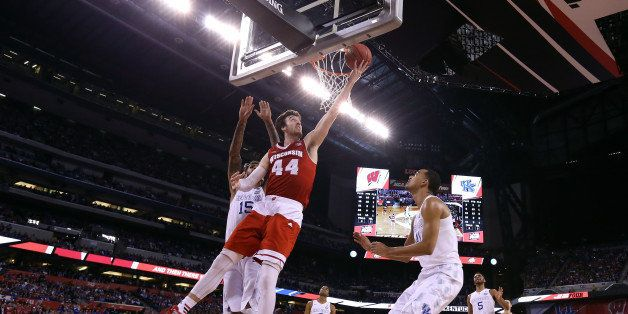 INDIANAPOLIS, IN - APRIL 04: Frank Kaminsky #44 of the Wisconsin Badgers drives to the basket against Willie Cauley-Stein #15