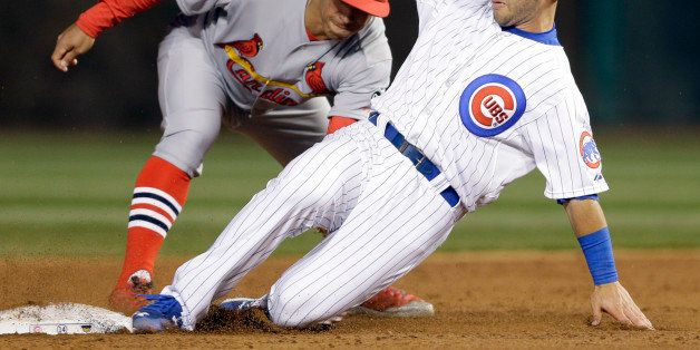 Chicago Cubs' Tommy La Stella, right, steals second base as St. Louis Cardinals second baseman Kolten Wong applies a late tag