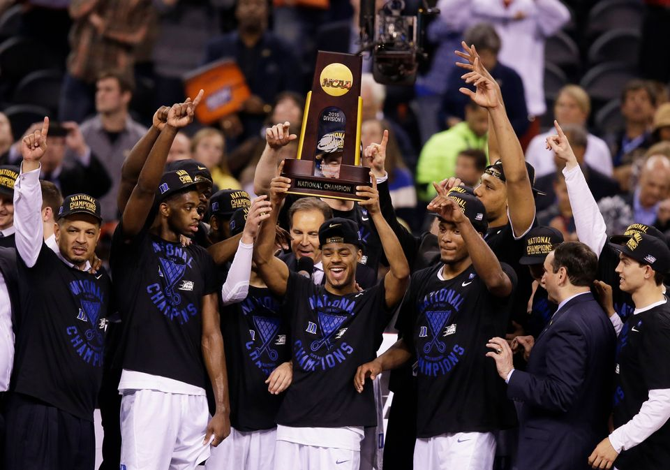 Duke players celebrate with the trophy after their 68-63 victory over Wisconsin in the NCAA Final Four college basketball tou