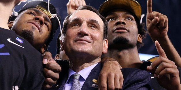 INDIANAPOLIS, IN - APRIL 06:  Head coach Mike Krzyzewski of the Duke Blue Devils watches 'One Shining Moment' with Quinn Cook