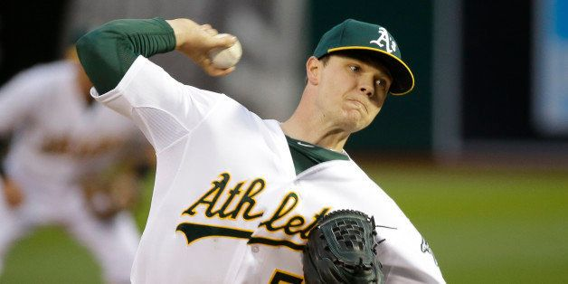 Oakland Athletics starting pitcher Sonny Gray throws against the Texas Rangers in the first inning of their opening day baseb