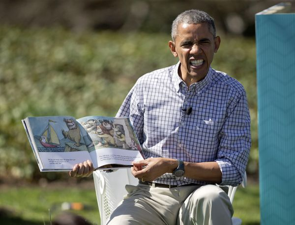 "President Barack Obama makes a face as he reads ""Where the Wild Things Are"" by Maurice Sendak."