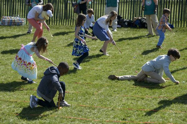 Children participate in the annual Easter Egg Roll on the South Lawn of the White House.