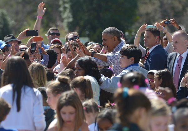 "President Barack Obama greets children after reading ""Where the Wild Things Are"" by Maurice Sendak."