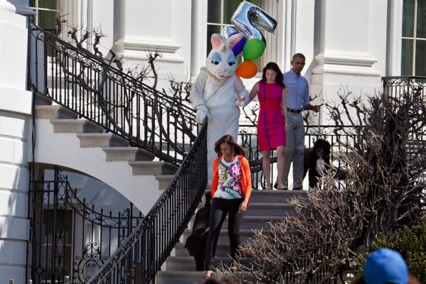 First lady Michelle Obama, left, along with the two presidential pet dogs Sunny and Bo, President Barack Obama, right, the Ea