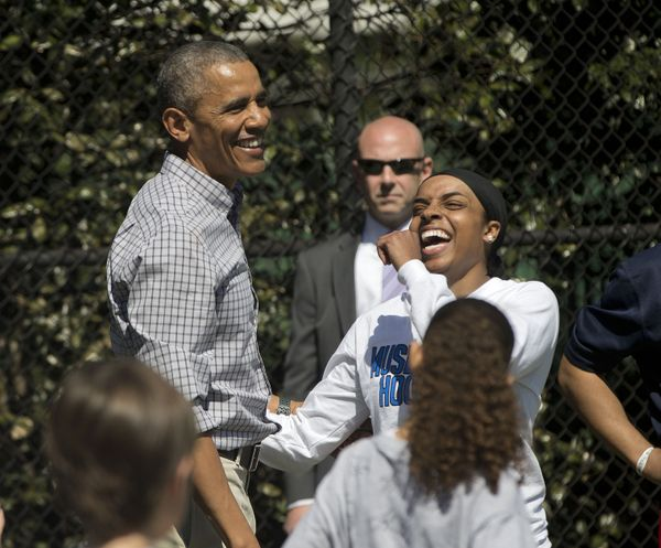 President Barack Obama, left, with Bilqis Abdul-Qaadir, right, a female Muslim American collegiate basketball player for the