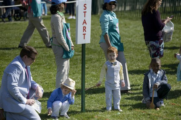 Children participate in the Easter Egg Roll on the South Lawn of the White House.