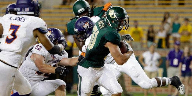 Northwestern State inebacker Adam Jones (3) gives chase as Baylor's Silas Nacita (31) fights his way into the end zone for a